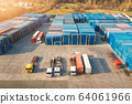 Aerial view of trucks and containers at sunset.  Top view of autotrucks, container warehouse 64061966