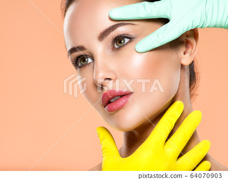 Face skin check before plastic surgery. Beautician 64070903
