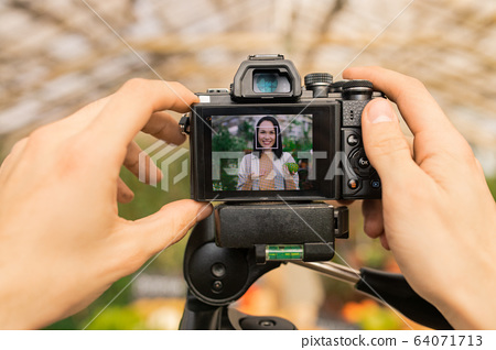 Shooting video with Asian farmer 64071713