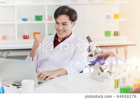 Scientist happy hand sign of winner and successful 64088276