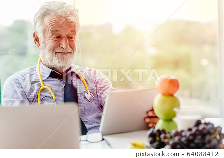 Professional nutrition health advisor doctor happy working at office desk with fruit 64088412