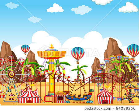 Themepark scene with many rides on the desert 64089250