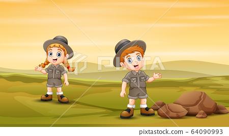 Safari kids in the green field 64090993