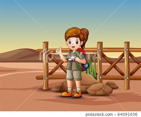 The explorer girl in the desert landscape 64091036