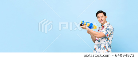 Asian man playing with water gun in banner size 64094972