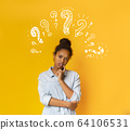 Puzzled pensive young african american teen girl with question marks 64106531