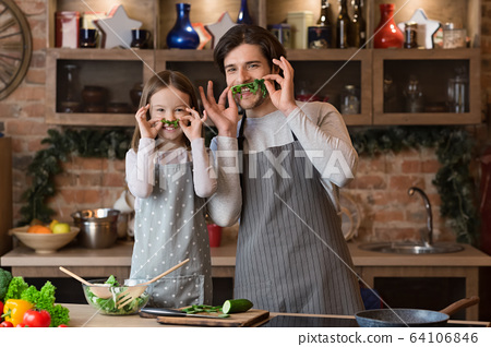 Isolation With Fun. Happy Father And Little Daughter Fooling In Kitchen 64106846