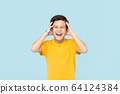 Happy smiling Asian boy with hands squeezing head 64124384