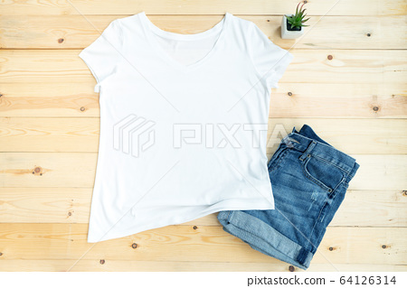White female t shirt mock up flat lay on wooden 64126314