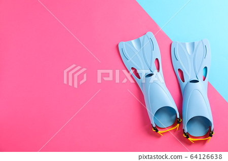 Blue flippers on two tone background, space for 64126638