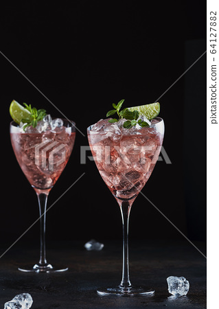 Summer cocktail with rose wine 64127882