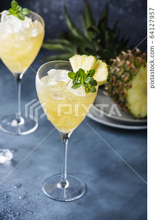 cocktail with pineapple 64127957