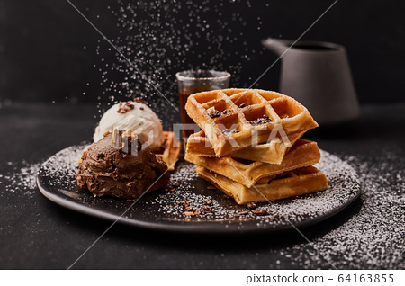 waffle with ice cream and caramel sauce.. 64163855