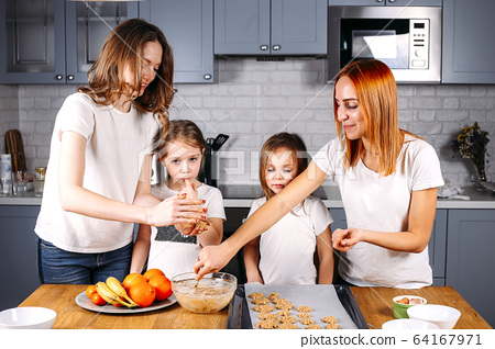 Portrait of happy mothers and two daughters 64167971