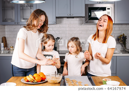 Portrait of happy mothers and two daughters 64167974