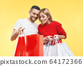 Young happy couple holding shopping bags in hands and looking their purchase 64172366
