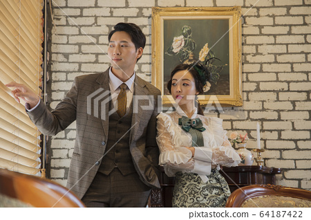 Portrait of female and male in retro fashion and vintage concept 380 64187422