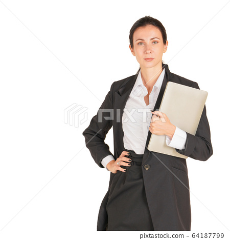 A business woman in a black suit holding on a computer notebook. 64187799