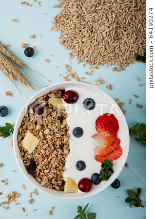 Delicious and healthy breakfast concept - cereal, Porridge and Energy bar 039 64190274