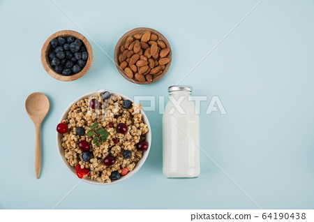 Delicious and healthy breakfast concept - cereal, Porridge and Energy bar 100 64190438