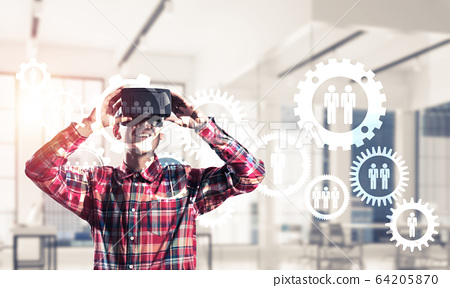 Guy wearing checked shirt and virtual mask demonstrating some em 64205870