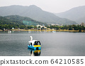 Duck boat on lake with mountain at Uirimji Reservoir in Jecheon, Korea 64210585