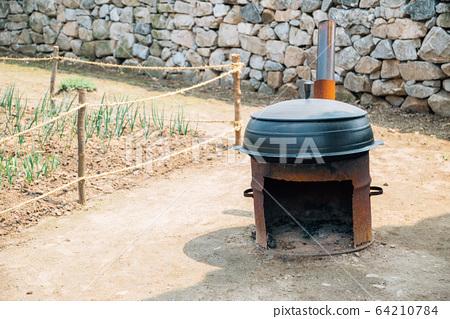Iron pot and Korean traditional fireplace at Haemieupseong Fortress in Seosan, Korea 64210784