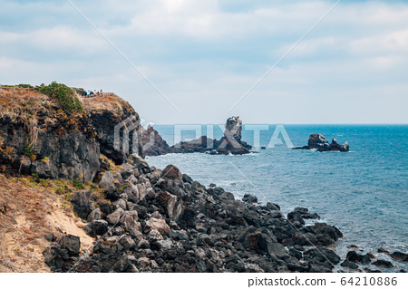 Seopjikoji sea and rock formation in Jeju Island, Korea 64210886