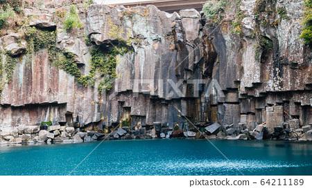 Cheonjeyeon waterfall in Jeju Island, Korea 64211189