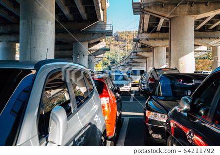 Car parking lot under bridge 64211792