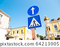 Traffic sign pedestrian crossing in European old town 64213005
