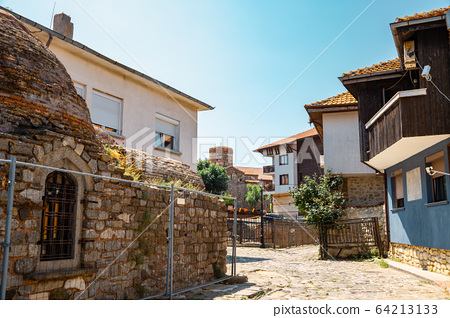 Ancient ruins and old town street in Nessebar, Bulgaria 64213133