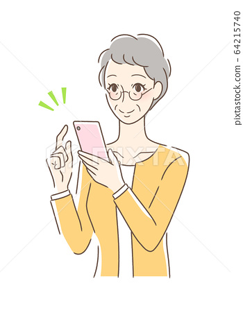 Smiling woman operating a smartphone 64215740