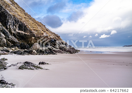 The beach and caves at Maghera Beach near Ardara, County Donegal - Ireland. 64217662