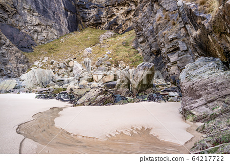 The beach and caves at Maghera Beach near Ardara, County Donegal - Ireland. 64217722