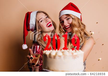 Fascinating girls enjoying christmas photoshoot 64218938