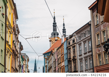 Old town buildings and Church of Our Lady of the Snows in Olomouc, Czech Republic 64224216