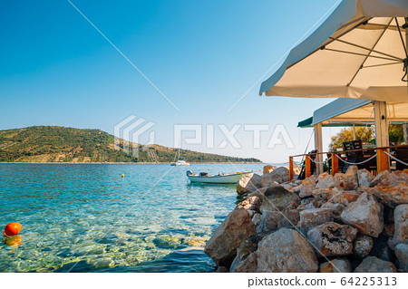 Adriatic beach at summer in Primosten, Croatia 64225313