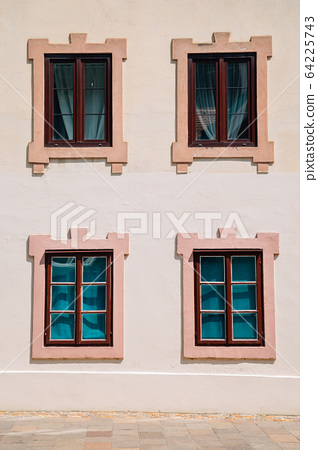 Classic window on beige wall 64225743