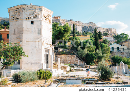 Roman Agora Tower of the Winds and Acropolis ancient ruins in Athens, Greece 64226432