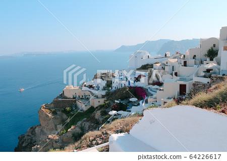 Oia town on Santorini island, Greece. Traditional houses and sea 64226617