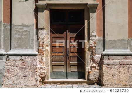 Old house exterior wooden antique door in Veszprem, Hungary 64228780