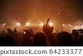 Celebrate. Party People Rock Concert. Crowd Happy and Joyful and Applauding or Clapping. Celebration party festival happiness. Blurry night club. Concert Show with DJ Music festival EDM on Stage 64233377