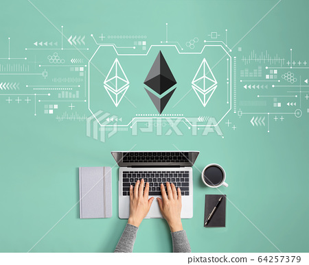 Ethereum with person using laptop 64257379