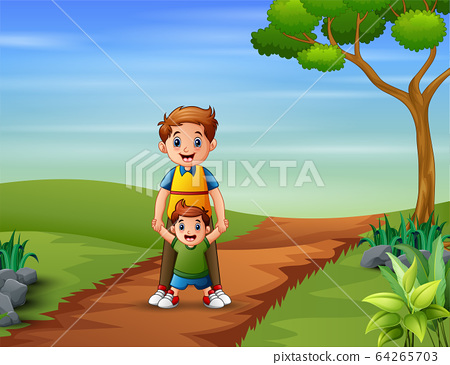 Father with his son playing on the hill 64265703