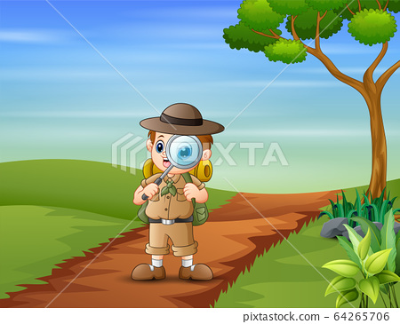 The explorer boy with magnifying glass on the road 64265706