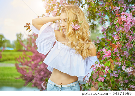 Beautiful young blonde hair woman in long pink 64271969