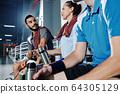 Badminton player talking to his teammates 64305129