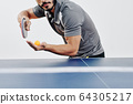Ping pong player serving ball 64305217
