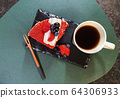 strawberry cake on a black plate and coffee 64306933